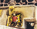 Man at work on tannery in Fes.jpg