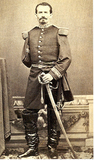 Manuel González Flores - Full-length picture in military regalia, showing the loss in battle of his right arm.