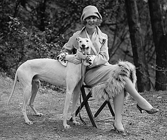 "Greyhound - Margaret Gorman with her pet Greyhound, ""Long Goodie"", in April 1925"