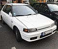 Mazda 323 GLX 4WD hatchback (front right) Berlin.jpg