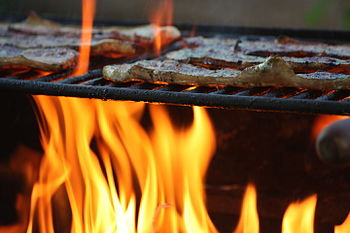 Meat fillets being grilled.jpg