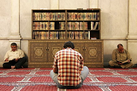 Muslim men reading the Quran Men reading the Koran in Umayyad Mosque, Damascus, Syria.jpg
