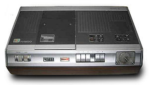 Video Cassette Recording - An N1500 video recorder, with wooden cabinet.