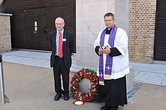 Hoxton railway station - The rededication of the North London Railway War Memorial in 2011, attended by TfL's Peter Hendy and the Revd James Westcott of St Chad's Church.