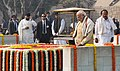 Narendra Modi paying homage at the Samadhi of Mahatma Gandhi on the occasion of Martyr's Day, at Rajghat, in Delhi. The Union Minister for Urban Development, Housing and Urban Poverty Alleviation and Parliamentary Affairs.jpg