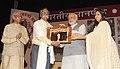 Narendra Modi presenting the 50th Jnanpeeth Award to Eminent Marathi littérateur Prof. Bhalchandra Nemade, at the 50th Jnanpeeth Award Ceremony, at Balayogi Auditorium, Parliament Library, in New Delhi on April 25, 2015 (1).jpg