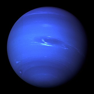 Neptune - Neptune's Great Dark Spot and its companion bright smudge; on the west limb the fast moving bright feature called Scooter and the little dark spot are visible.