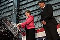 New Hampshire Senator breaks a bottle across the ship's bow during a christening ceremony. (26638605810).jpg