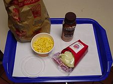 "A ""low fat"" child's meal from Burger King, with ""apple fries"" replacing fried potato chips, and a serving of macaroni and cheese as its main dish New KM.jpg"