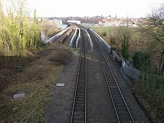 North Wales Coast Line - North Wales Coast Line between Chester and Saltney, showing the two tracks over the River Dee. The path of the other two tracks which were removed can also be seen.