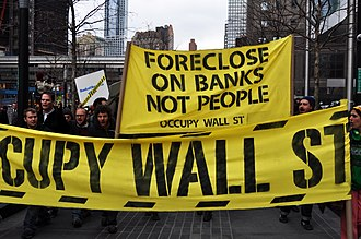 """Occupy Homes - Marchers hold a banner reading """"Foreclose On Banks Not People"""""""