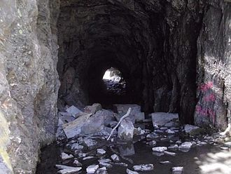 The Iron Trail - A hand-cut, unfinished tunnel on one of the aborted railroad projects from the era the film is set in