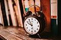 Old alarm clock on the bookshelf - 50233824038.jpg