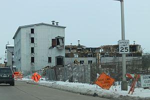 Menominee Nation Arena - Razing the Buckstaff building in February 2017