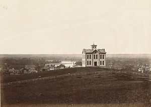 History of the University of Kansas - Old North College, the first building on KU Campus, overlooking Lawrence and the Kansas River, ca. 1867