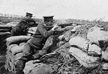 Photograph of two snipers firing from a trench