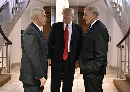 Trump conferring with Vice President Mike Pence and former secretary of homeland security John F. Kelly, January 25, 2017 POTUS visits DHS (31741970743).jpg