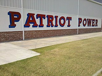 John Curtis Christian High School - Image: Patriot Power sign on side of the gym