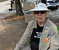 "People's Climate March 2017 in Washington DC 32 - An elderly marcher reflects on J. Edgar Hoover as she sits by the FBI building with her Nixon button and wonders ""Is it fascism yet?"".jpg"