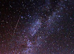 A meteor streaks across the sky during the 2009 Perseid shower