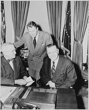 Oscar L. Chapman - Secretary of the Interior Oscar L. Chapman (right), Under Secretary of the Interior Jebby Davidson (center), and President Harry S. Truman, (December 21, 1950).