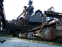 Pig iron cars entering the furnaces (276617775).jpg