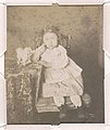 Portrait of an unidentified girl, full-length studio portrait, facing front, seated with right elbow resting on a table and with her left hand on the edge of the table, next to a dog LCCN2015651561.jpg