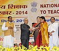 Pranab Mukherjee presenting the National Award for Teachers-2014 to Kumari Nagamma, Telangana, on the occasion of the 'Teachers Day', in New Delhi. The Union Minister for Human Resource Development, Smt. Smriti Irani.jpg