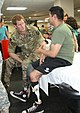 Prince Harry talks to an injured soldier.jpg