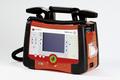 Professioneller Defibrillator mit Monitor.png