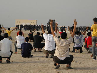 Aftermath of the Bahraini uprising (January–August 2012) - Protesters facing riot police in Karbabad beach.