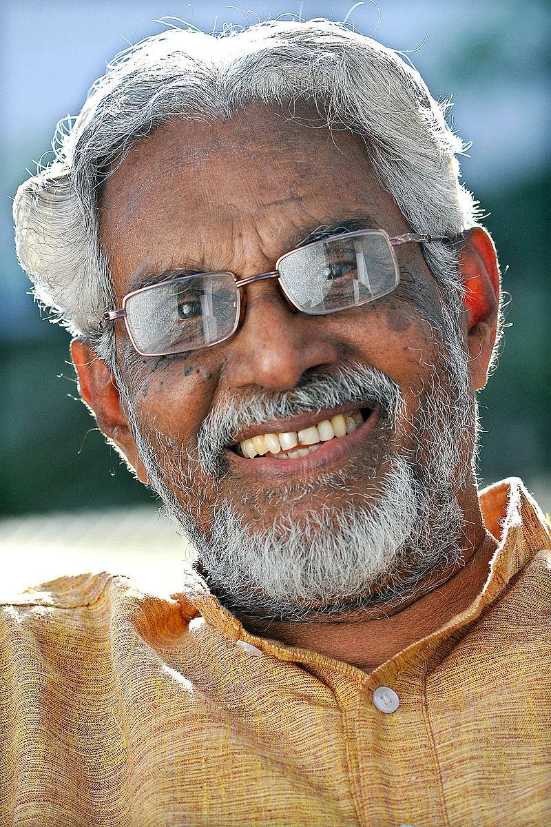 https://upload.wikimedia.org/wikipedia/commons/thumb/5/56/Puthussery_Ramachandran.jpg/800px-Puthussery_Ramachandran