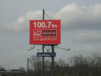 Qmusic (Netherlands) - An old logo of Q-music on a billboard.