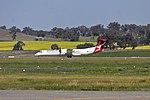 QantasLink (VH-LQB) Bombardier Dash 8 Q400 taking off from Wagga Wagga Airport.jpg