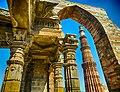 Qutub Minar as seen from ruins of Jain Temple.jpg