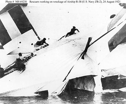 Rescuers scramble across the wreckage of British R-38/USN ZR-2, 24 August 1921. R-38-rescue.jpg