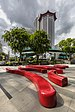 Red curved benches with Angsana trees near the Singapore Marriott Tang Plaza tower.jpg