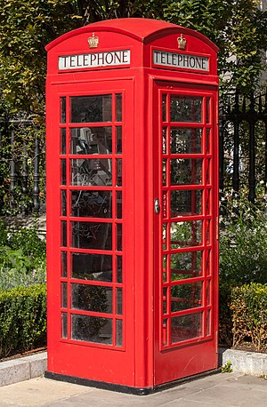 Red telephone box - An example of a K6, the most common red telephone box model, photographed in London in 2012. Like most K6s in central London today, this example is a modern 'heritage' installation.