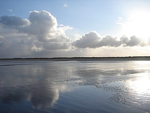 English: Reflections on Mablethorpe Beach Peac...