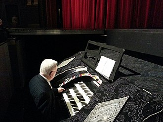"Bartola Musical Instrument Company - Spectacular console of the original installation 3 manual, 14 rank ""Rhinestone Barton"" theatre organ, installed in Theatre Cedar Rapids (the former RKO Iowa Theatre), Cedar Rapids, Iowa"