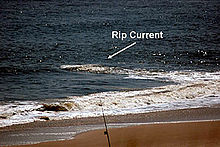 fdfa952e270b Disruption in the line of a breaking wave makes a rip current visible.