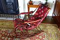 Rocking chair, bought at the Great Exhibition in 1851, iron and crimson morocco leather - Lord Harewood's Sitting Room - Harewood House - West Yorkshire, England - DSC01769.jpg