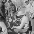 Rohwer Relocation Center, McGehee, Arkansas. A group of center farm workers assembling equipment, . . . - NARA - 539371.tif