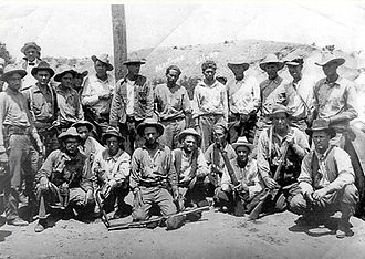 Posse comitatus - An American posse in 1922, which captured the outlaws Manuel Martinez and Placidio Silvas, who are in the center of the back row. Martinez and Silvas were arrested for the Ruby Murders after the largest manhunt in the history of the Southwest.