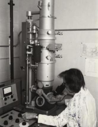 Ruth Bleier - Ruth Bleier looking into her electron microscope, 1980's
