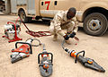 SRA Damean Moore, 506th Expeditionary Civil Engineering Squadron firefighter, inspects fire rescue equipment.jpg