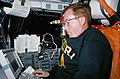 STS-41 Commander Richards uses DTO 1206 portable computer onboard OV-103.jpg