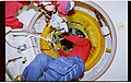 STS071-101-006 - STS-071 - STS-71 Gibson at docking hatch - DPLA - dbef073efb9fc06ef38ec2a8dc47b7aa.jpg