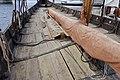 Saga Oseberg Details Wood deck (skipsdekk) Canvas tarp wrapped in yard (rå bom) Ores (årer) Oreholes (årehull) Shroud pins (vant) Gunwale (reling) etc. Viking ship replica 2012 Tønsberg harbour Norway 2019-08-16 04308.jpg