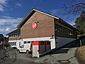 Salvation Army (Frelsesarmeen Stord korps) in Vidsteensvegen, Leirvik, Stord, Norway. With Fretex textiles collection boxes (tøyinnsamling). 2018-03-13.jpg